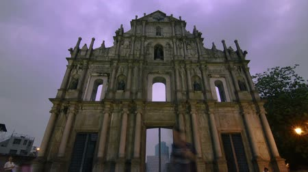 low lighting : Timelapse of clouds at a ruins of an old church - Ruins of St. Paul in Macau Stock Footage