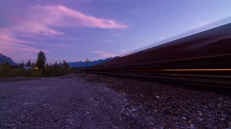 low lighting : 2 Shots of Train coming in and leaving Time lapse