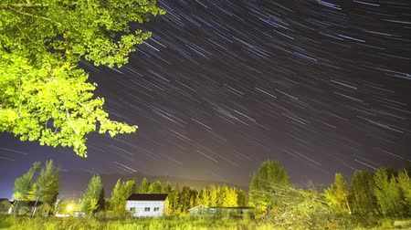 low lighting : Star trail Time lapse background over village Stock Footage