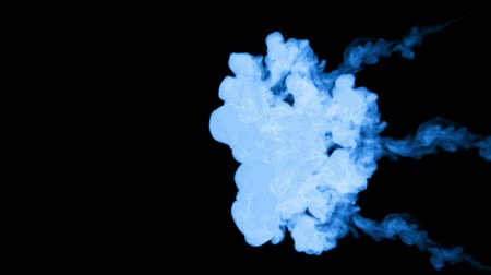 tenso : A lot of flows of fluorescent blue ink or smoke, isolated on black in slow motion. Blue colour float in water. Use for ink background, ink effects. Alpha channel is on use luma matte as alpha mask