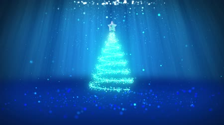 свечение : Wide angle shot of winter theme for Christmas or New Year background with copy space. Xmas tree from particles in mid-frame. Blue 3d Xmas tree V1 with glitter particles DOF light rays rotating space