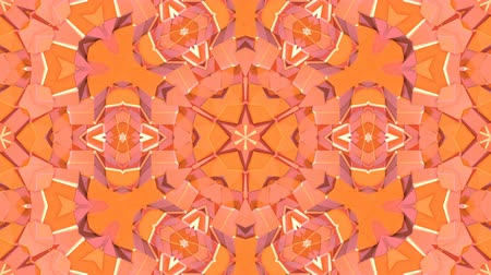 faceted : looped animation of 3d geometry, geometric forms and shapes are transformed. Orange composition in low poly style kaleidoscope effect. Motion graphics background for vj shows. 4k seamless footage .31