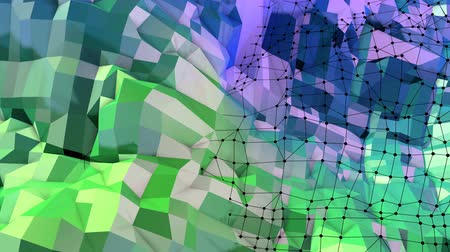 faceted : Abstract low poly style looped background. 3d seamless animation in 4k. Modern gradient colors. Green blue surface shimmers and shines with grid. 1