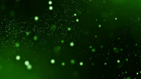 yumuşaklık : 3d green background with fantastic luminous particles. Looped 3d animation with depth of field, light effects. Modern digital background. point field 3 Stok Video