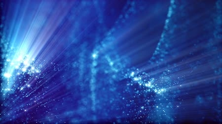 lights up : Microcosm or space. Seamless looped footage with beautiful light effects and 3d animation of glow particles with depth of field, bokeh and light rays for abstract background or vj loop. Blue 11 Stock Footage