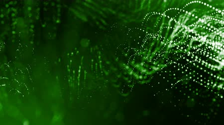 bg : abstract looped dynamic composition of luminous particles like garland. Abstract particle background with depth of field.
