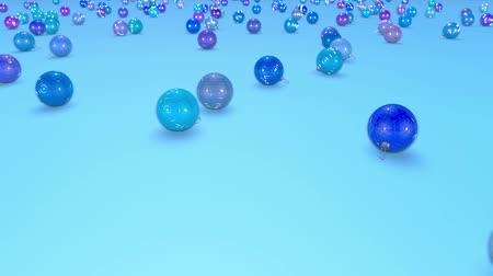 large number of : christmas balls fall crumble to the surface with depth of field. 3d animation for new year compositions or background. shades of blue 1