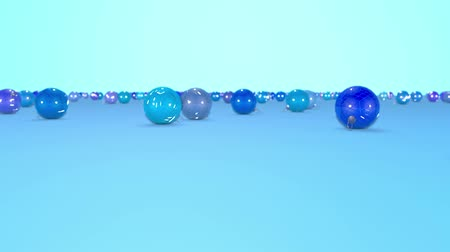 good new year spirit : christmas balls fall crumble to the surface with depth of field. 3d animation for new year compositions or background. shades of blue 3