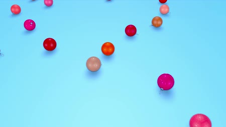 ilginç : christmas balls fall crumble to the surface with depth of field. 3d animation for new year compositions or background. shades of red 5