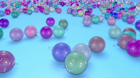 congratulating : christmas balls fall crumble to the surface with depth of field. 3d animation for new year compositions or background. 1 multicolor