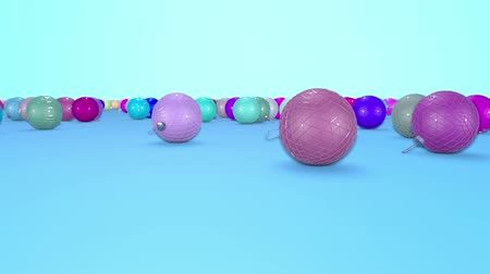 good new year spirit : christmas balls fall crumble to the surface with depth of field. 3d animation for new year compositions or background. multicolor