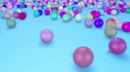 С Рождеством : christmas balls fall crumble to the surface with depth of field. 3d animation for new year compositions or background. multicolor