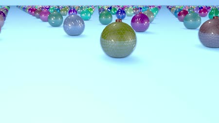 good new year spirit : christmas balls on surface in a rows. 3d animation for new year compositions or background with depth of field. amera moves smoothly above the surface. Multi colored 2