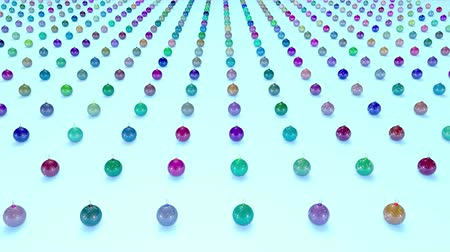 good new year spirit : christmas balls on surface in a rows. 3d animation for new year compositions or background with depth of field. amera moves smoothly above the surface. Multi colored 3