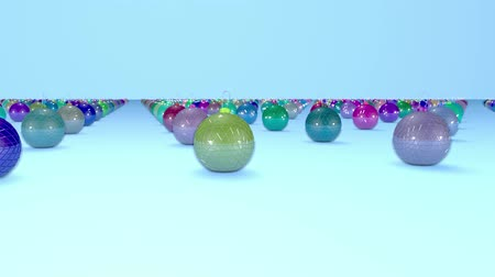 good new year spirit : christmas balls on surface in a rows. 3d animation for new year compositions or background with depth of field. amera moves smoothly above the surface. Multi colored 6 Stock Footage