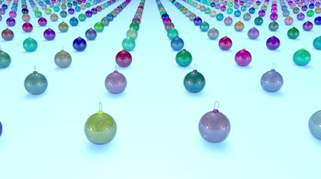large number of : christmas balls on surface in a rows. 3d animation for new year compositions or background with depth of field. amera moves smoothly above the surface. Multi colored 8