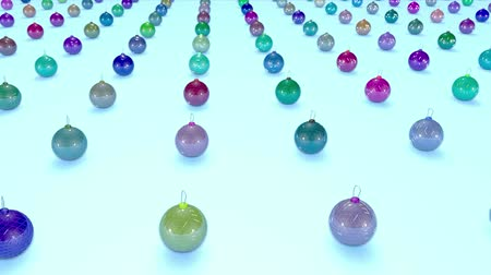 good new year spirit : christmas balls on surface in a rows. 3d animation for new year compositions or background with depth of field. amera moves smoothly above the surface. Multi colored 9
