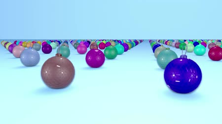 odskočit : christmas balls on surface in a rows. 3d animation for new year compositions or background with depth of field. amera moves smoothly above the surface. Multi colored 11