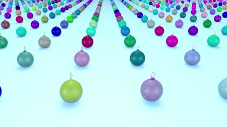 good new year spirit : christmas balls on surface in a rows. 3d animation for new year compositions or background with depth of field. amera moves smoothly above the surface. Multi colored 13