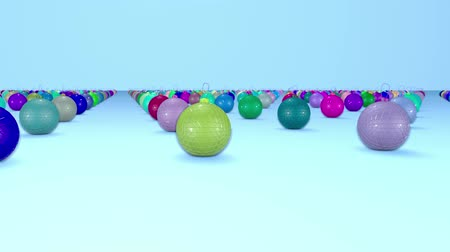 good new year spirit : christmas balls on surface in a rows. 3d animation for new year compositions or background with depth of field. amera moves smoothly above the surface. Multi colored 15 Stock Footage