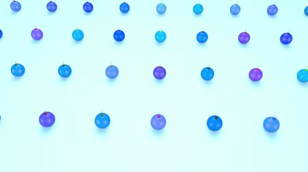 large number of : christmas balls on surface in a rows. 3d animation for new year compositions or background with depth of field. amera moves smoothly above the surface. Blue shades 7
