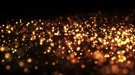 luma matte : gold particles in liquid float and glisten. Background with glittering golden particles depth of field and bokeh. Luma matte to cut out glowing particles for holiday presentations. 4k 3d animation. 6