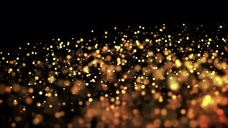 profundidade de campo rasa : gold particles in liquid float and glisten. Background with glittering golden particles depth of field and bokeh. Luma matte to cut out glowing particles for holiday presentations. 4k 3d animation. 9