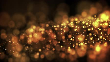 solene : gold particles in liquid float and glisten. Background with glittering golden particles depth of field and bokeh. Luma matte to cut out glowing particles for holiday presentations. 4k 3d animation. 11 Stock Footage