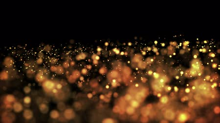 csillogás : gold particles in liquid float and glisten. Background with glittering golden particles depth of field and bokeh. Luma matte to cut out glowing particles for holiday presentations. 4k 3d animation. 14 Stock mozgókép