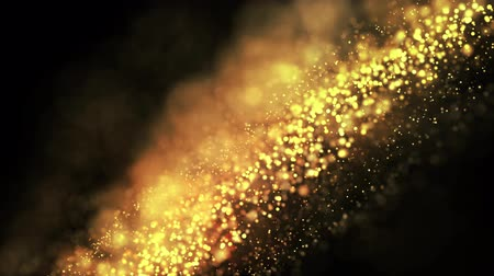hvězdnatý : gold particles in liquid float and glisten. Background with glittering golden particles depth of field and bokeh. Luma matte to cut out glowing particles for holiday presentations. 4k 3d animation. 23
