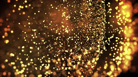 abundante : gold particles in liquid float and glisten. Background with glittering golden particles depth of field and bokeh. Luma matte to cut out glowing particles for holiday presentations. 4k 3d animation. 24 Vídeos