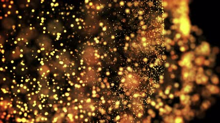desfocado : gold particles in liquid float and glisten. Background with glittering golden particles depth of field and bokeh. Luma matte to cut out glowing particles for holiday presentations. 4k 3d animation. 25