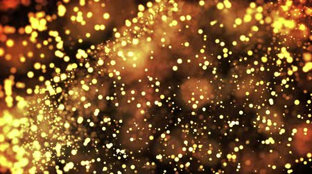 ünnepélyes : gold particles in liquid float and glisten. Background with glittering golden particles depth of field and bokeh. Luma matte to cut out glowing particles for holiday presentations. 4k 3d animation. 29