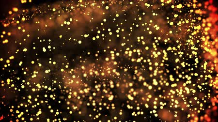desfocado : gold particles in liquid float and glisten. Background with glittering golden particles depth of field and bokeh. Luma matte to cut out glowing particles for holiday presentations. 4k 3d animation. 36