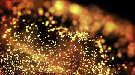 abundante : gold particles in liquid float and glisten. Background with glittering golden particles depth of field and bokeh. Luma matte to cut out glowing particles for holiday presentations. 4k 3d animation. 42 Vídeos