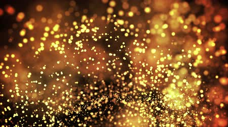 raso : gold particles in liquid float and glisten. Background with glittering golden particles depth of field and bokeh. Luma matte to cut out glowing particles for holiday presentations. 4k 3d animation. 43