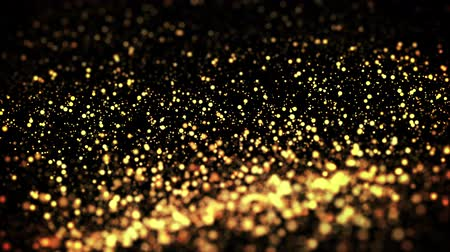 prim : gold particles in liquid float and glisten. Background with glittering golden particles depth of field and bokeh. Luma matte to cut out glowing particles for holiday presentations. 4k 3d animation. 57