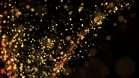abundante : gold particles in liquid float and glisten. Background with glittering golden particles depth of field and bokeh. Luma matte to cut out glowing particles for holiday presentations. 4k 3d animation. 62
