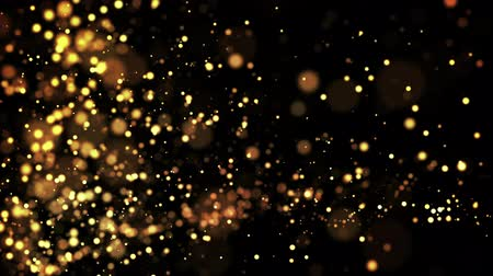golden particles : gold particles in liquid float and glisten. Background with glittering golden particles depth of field and bokeh. Luma matte to cut out glowing particles for holiday presentations. 4k 3d animation. 64