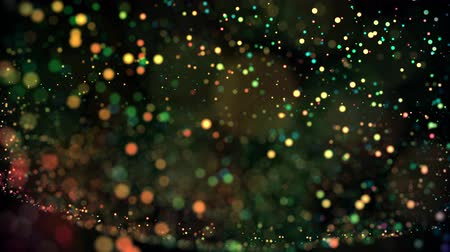 flutuador : multicolored particles in liquid float and glisten. 4k 3d advection background with glittering particles, depth of field and bokeh isolated on black. Luma matte to cut out particles. 3