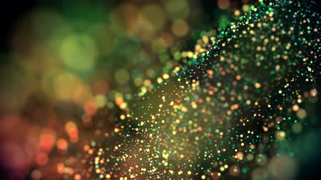 prim : multicolored particles in liquid float and glisten. 4k 3d advection background with glittering particles, depth of field and bokeh isolated on black. Luma matte to cut out particles. 6 Stok Video