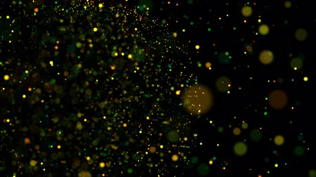 csillogás : multicolored particles in liquid float and glisten. 4k 3d advection background with glittering particles, depth of field and bokeh isolated on black. Luma matte to cut out particles. 54