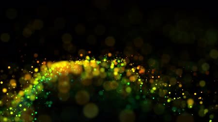 prim : multicolored particles in liquid float and glisten. 4k 3d advection background with glittering particles, depth of field and bokeh isolated on black. Luma matte to cut out particles. 69 Stok Video