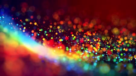 цветной : multicolored particles like confetti or spangles float in a viscous liquid and glitter in the light with depth of field. 3d abstract animation of particles in 4k. luma matte as the alpha channel. 8 Стоковые видеозаписи