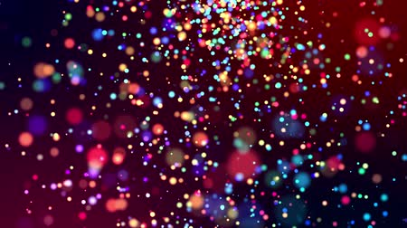 profundidade de campo rasa : multicolored particles like confetti or spangles float in a viscous liquid and glitter in the light with depth of field. 3d abstract animation of particles in 4k. luma matte as the alpha channel. 24