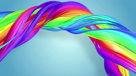 abstrato : multi-color ribbon is twisted and moves in a circle. Rainbow colored ribbon LGBT symbol animated in motion design with copy space. Looped smooth animation in 4K. Ver 27 Stock Footage