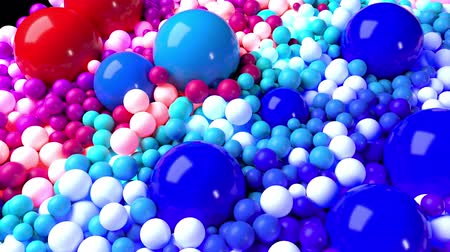 nagy felbontású : 3D looped animation with bright beautiful small and large spheres or balls as an abstract holiday background. Ð¡olorful composition of colorful spheres Stock mozgókép