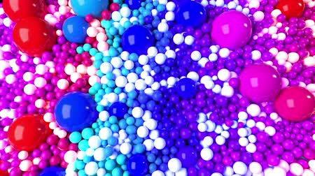 wallow : 3D looped animation with bright beautiful small and large spheres or balls as an abstract holiday background. Ð¡olorful composition of colorful spheres Stock Footage