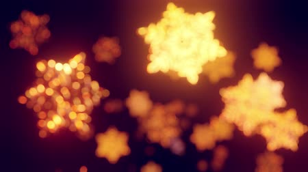 abstract animated : 3d golden christmas background with bokeh and depth of field of shiny toy snowflakes hanging in the air beautifully shiny slowly swaying and shining in the light. Beautiful 3d for new year in 4k