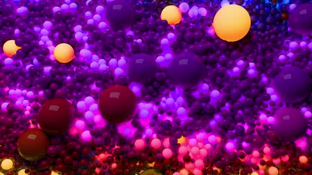 высокое разрешение : 3D loop of animation in 4k with beautiful small and large spheres or balls as an abstract holiday background. Beautiful composition of colorful glowing spheres